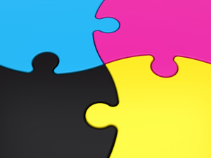 A four piece puzzle, put together, in cyan, magenta, yellow and black.