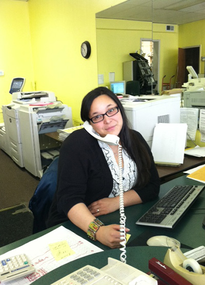 A photo of Diana, the manager at Moss Printing in Mission and Merriam, Kansas stores